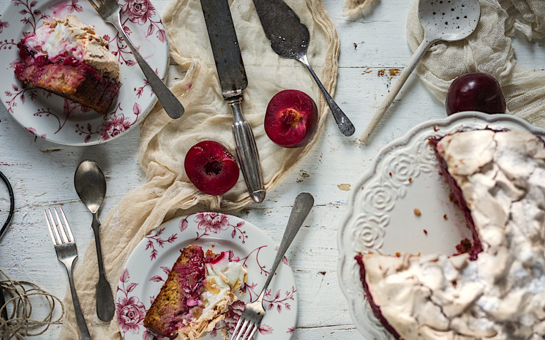 Plums and coconut with crispy meringue cake. Louisse cake