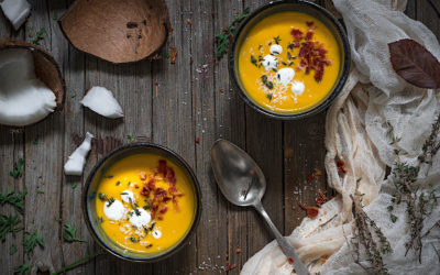 Cream of curried carrots and crispy bacon